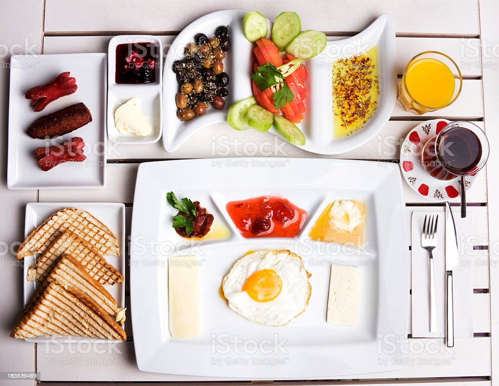 White plates of fresh breakfast foods royalty-free stock photo