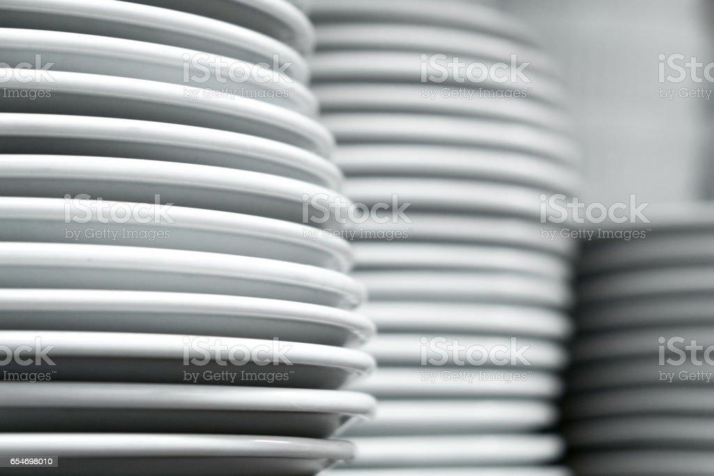 White plates on white background stock photo