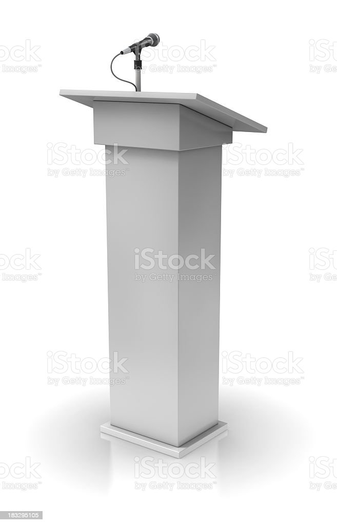 White podium with a single microphone stock photo