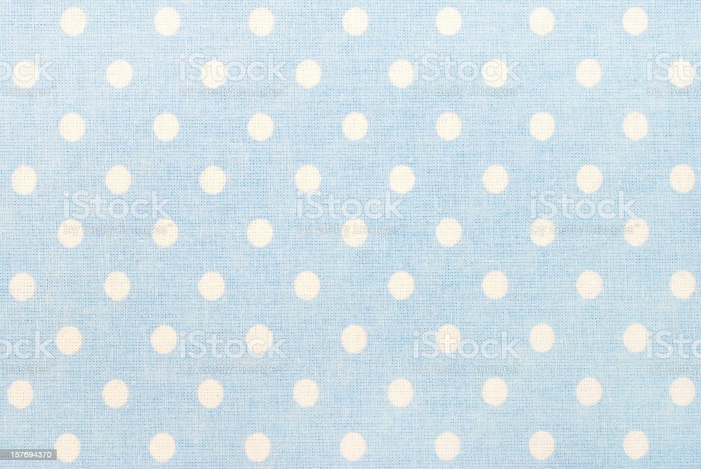 white polka dots on blue stock photo