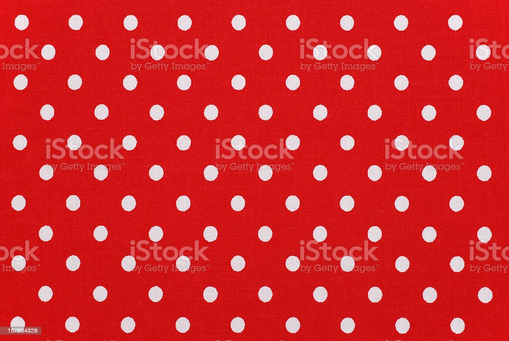 white polka dots on red fabric stock photo