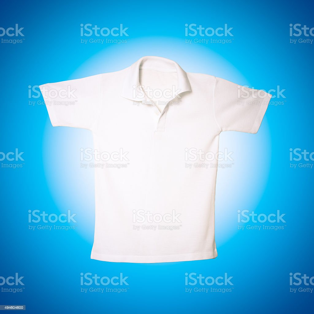 White polo shirt on blue background stock photo