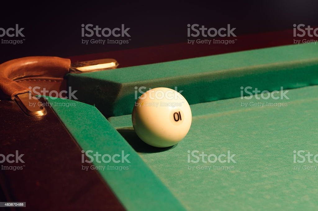 White Pool Ball Near Hole of the Table stock photo