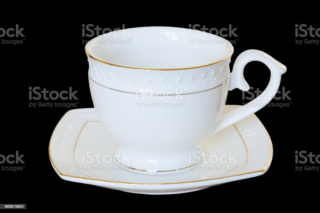 White porcelain cup with a saucer for tea or coffee, demitasse or teacup. Isolated,   black background. stock photo