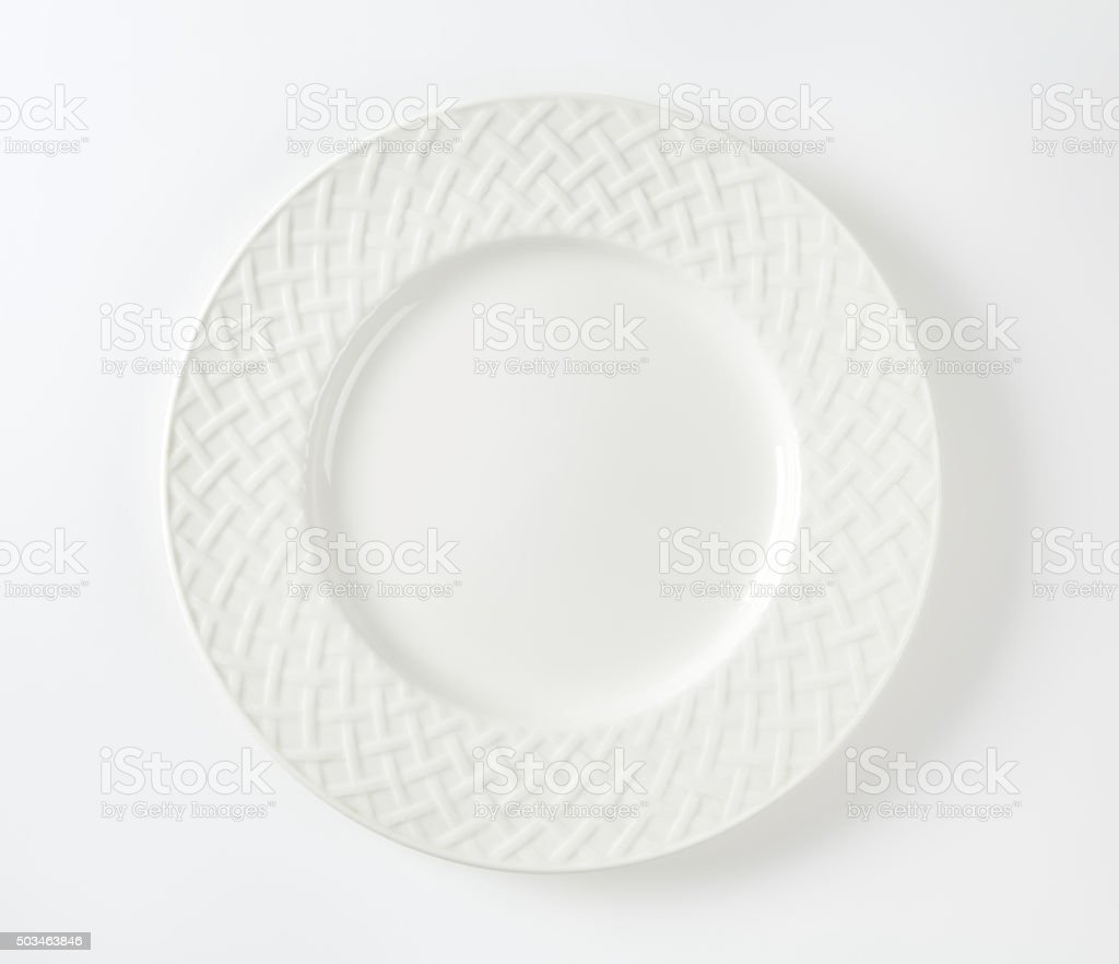 White porcelain plate with decorative rim stock photo