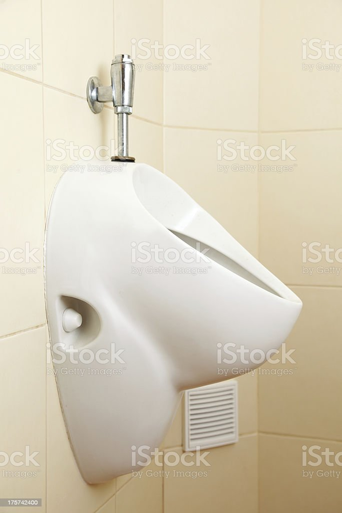 White porcelain urinal in public toilets royalty-free stock photo