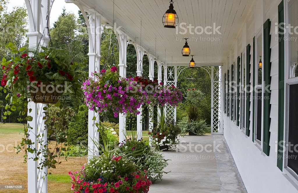 White porch full of flowers stock photo