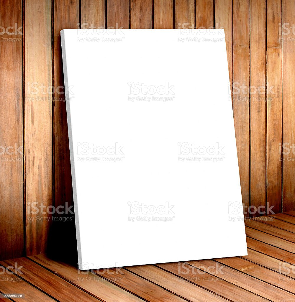 white poster frame in wooden room stock photo