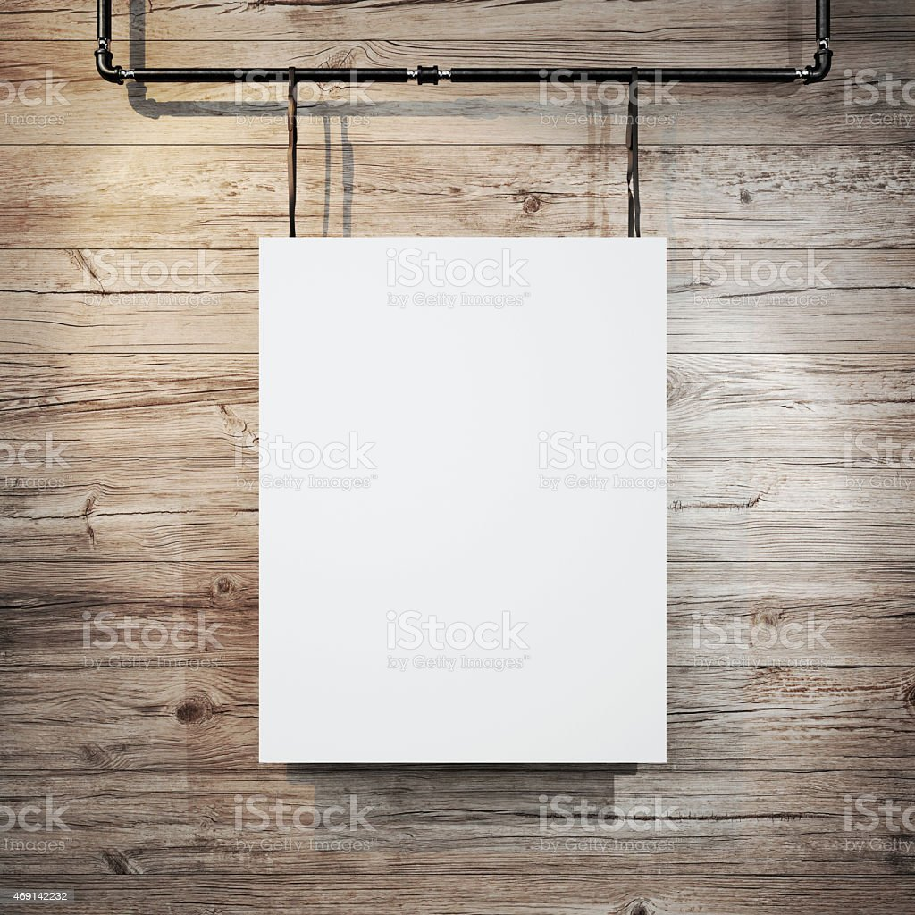 White poster hanging on leather belt on wood background stock photo