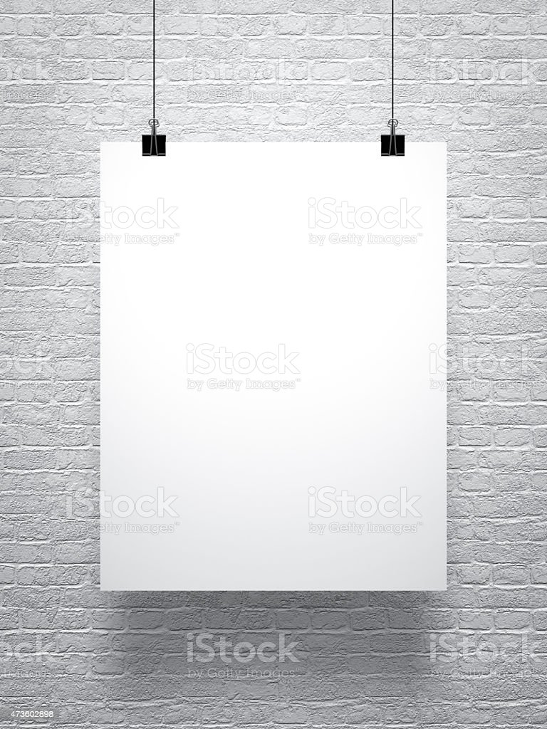 white poster on brick wall stock photo