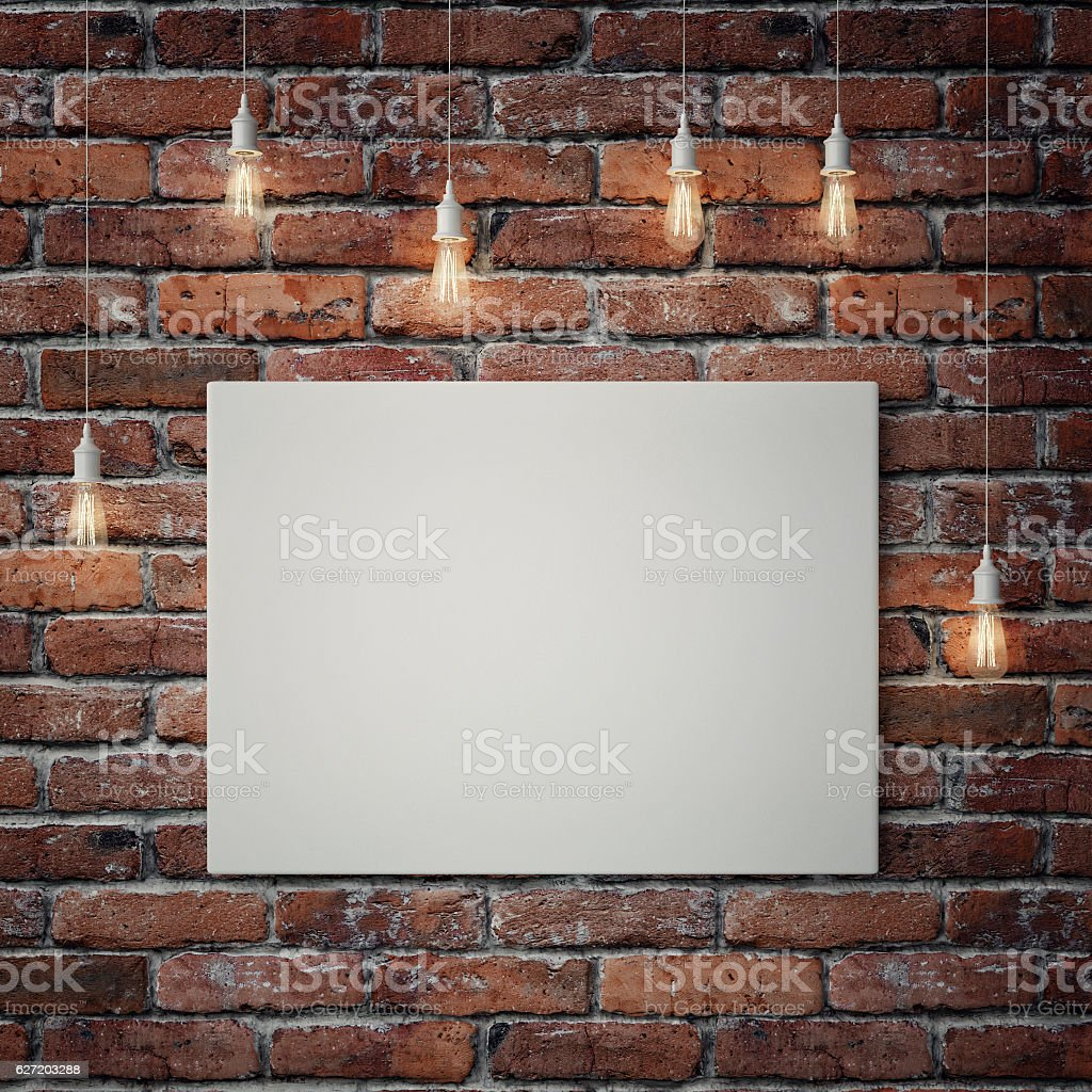 White poster with light bulbs on red brick wall stock photo