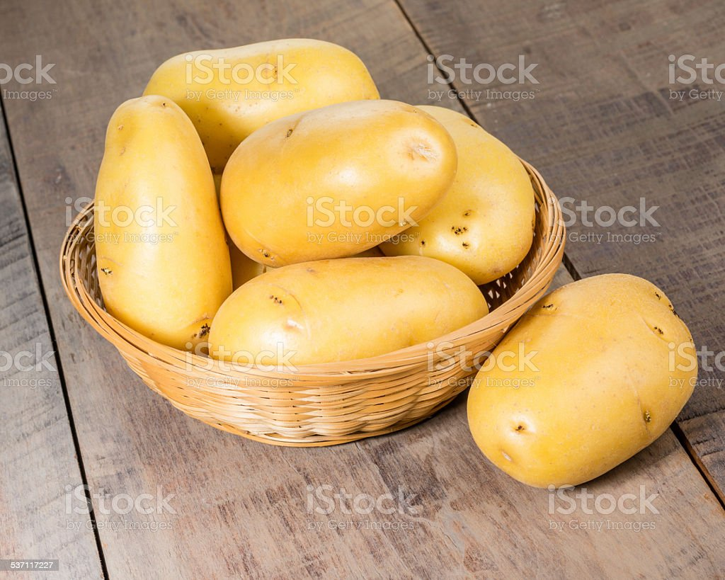 White potatoes fresh picked in wicker bowl stock photo