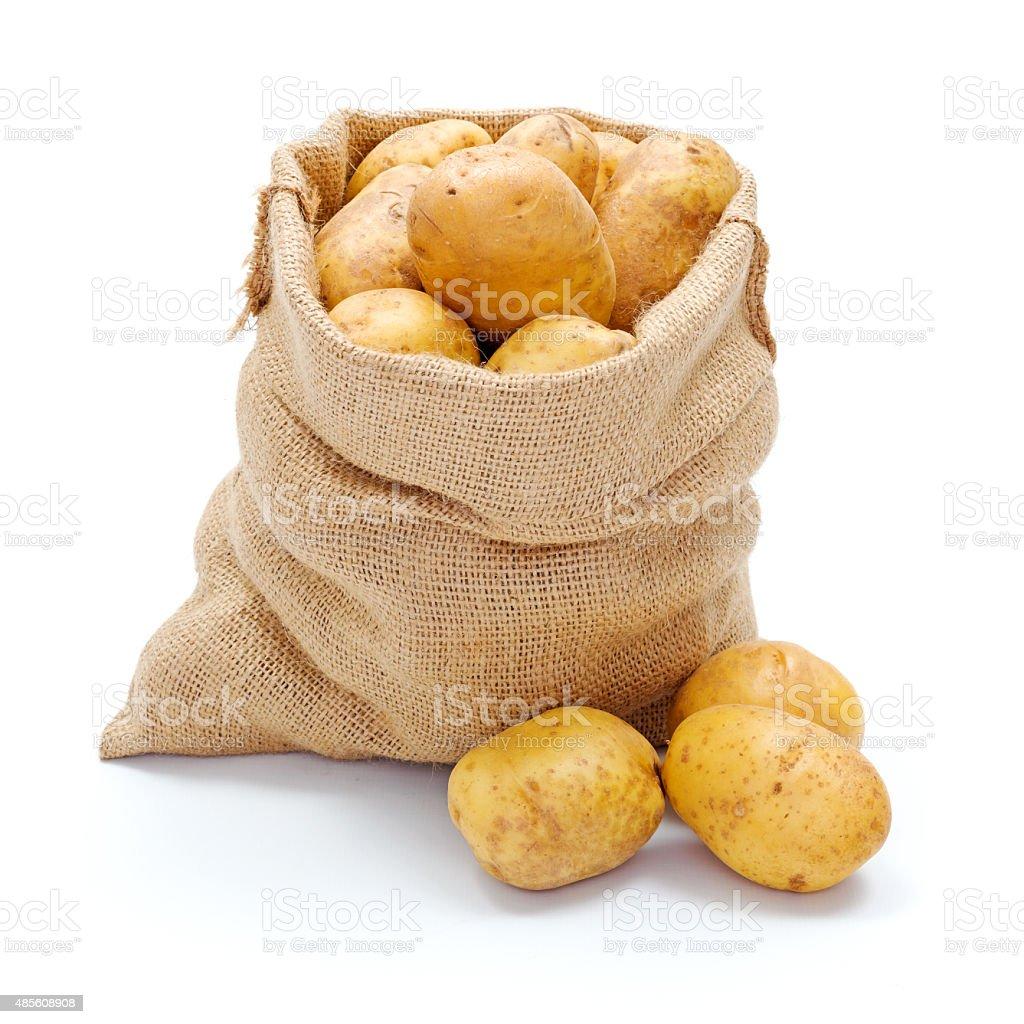 White potatoes in burlap sack stock photo