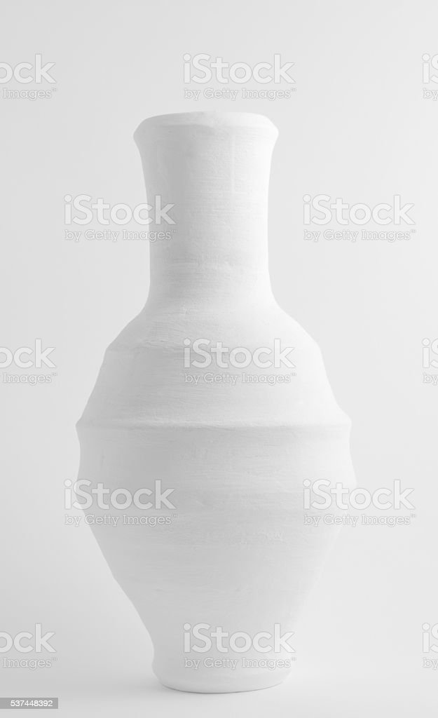 White pottery vessel on white background stock photo