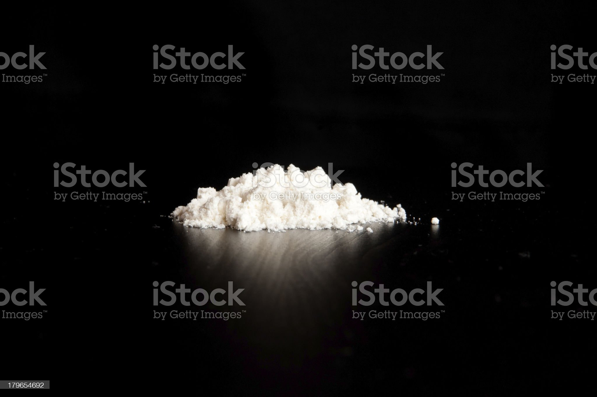 White powder on reflective surface and black background royalty-free stock photo