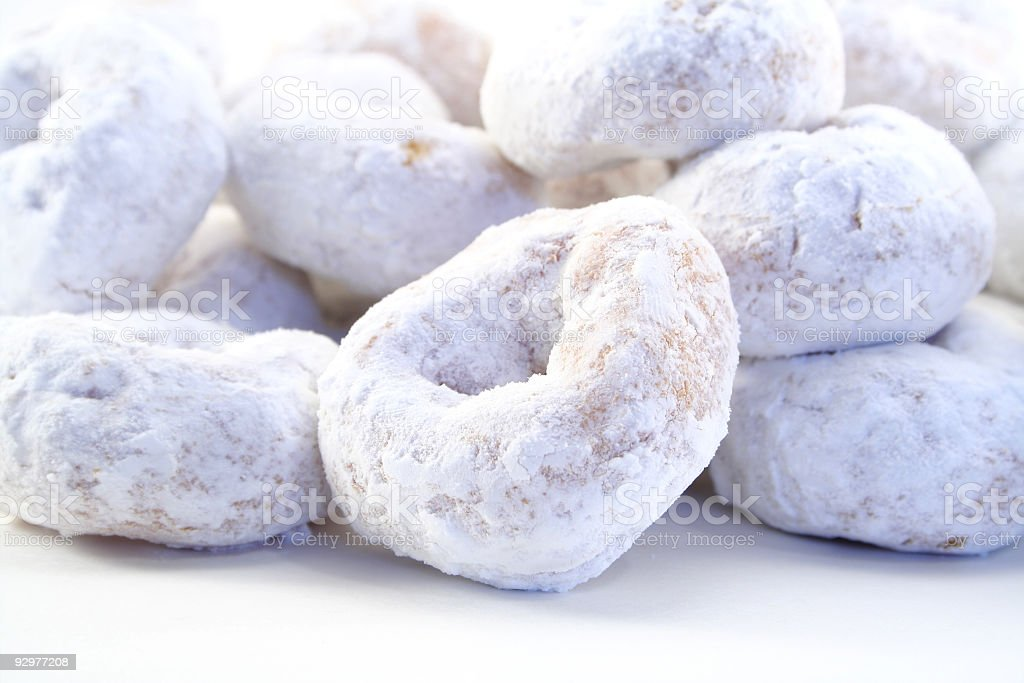 White powdered sugar donuts on white background stock photo