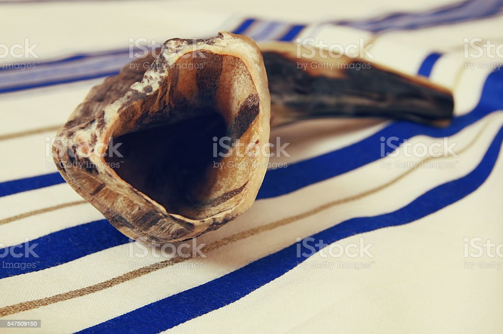 White Prayer Shawl - Tallit, and Shofar (horn). Jewish religious stock photo