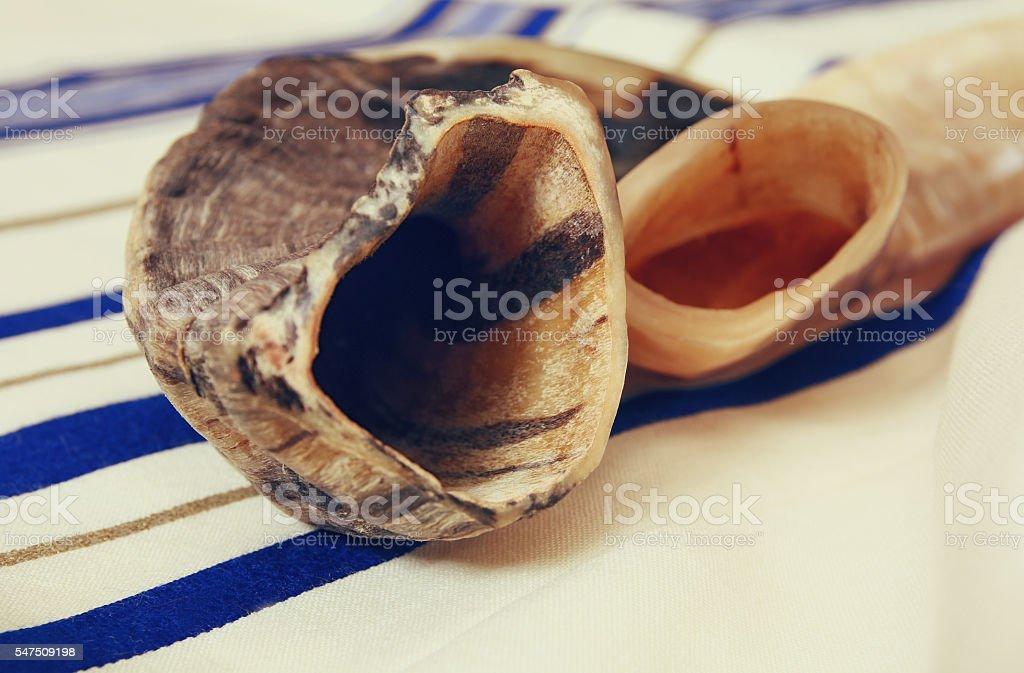 White Prayer Shawl - Tallit, and Shofar (horn). Jewish religious stock photo