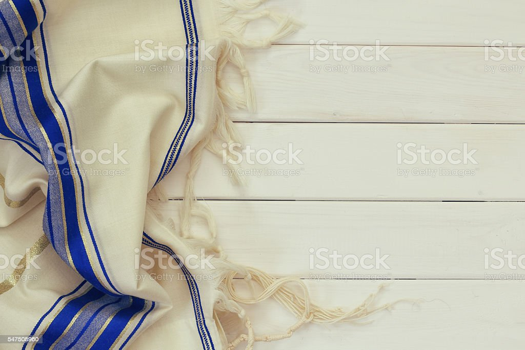 White Prayer Shawl - Tallit, jewish religious symbol. stock photo