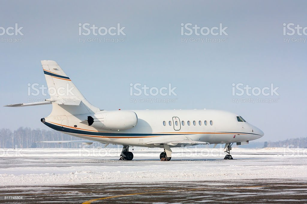 White private plane in a cold winter airport royalty-free stock photo