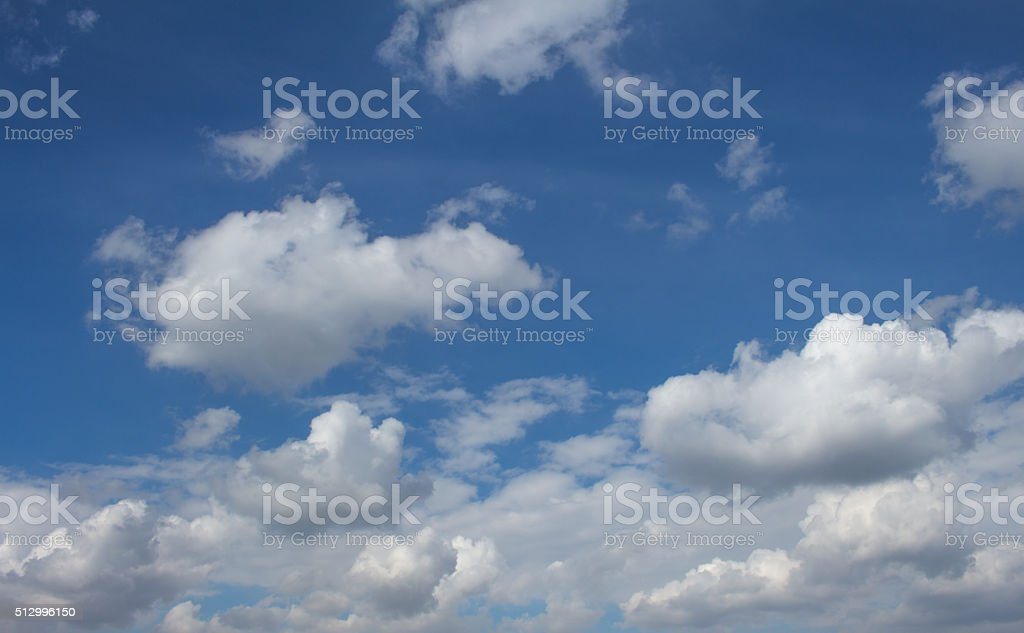 White puffy clouds stock photo
