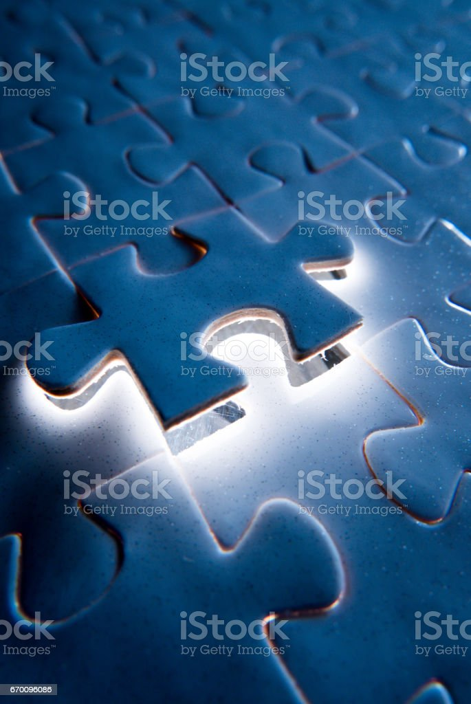 White puzzle with a missing piece stock photo