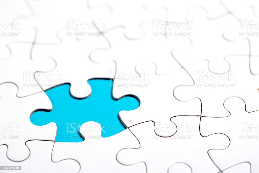 White puzzle with missing part stock photo