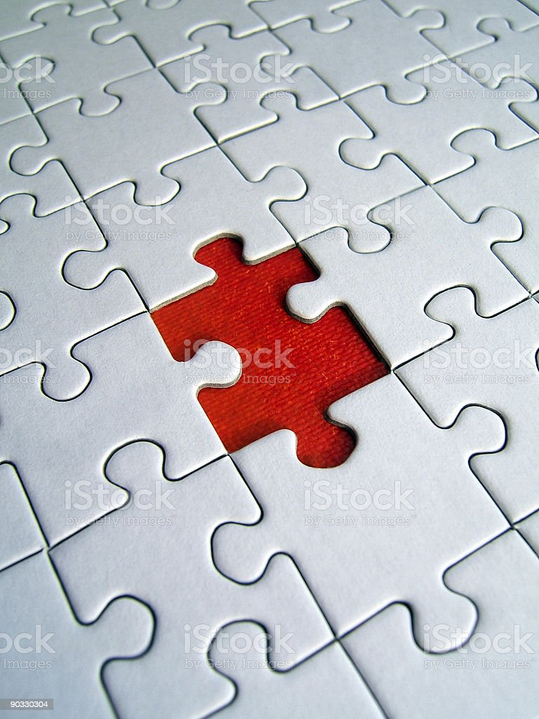 White puzzle with one missing piece stock photo
