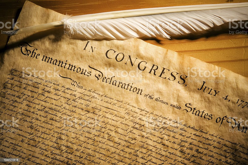 A white quill on a copy of the Declaration of Independance stock photo