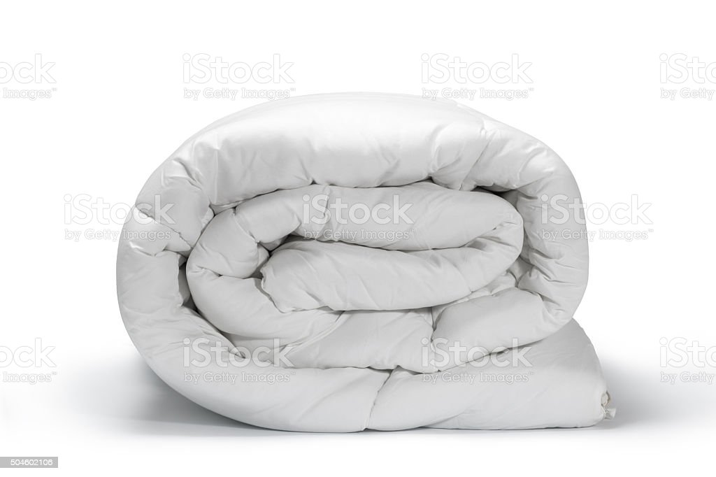white quilt stock photo