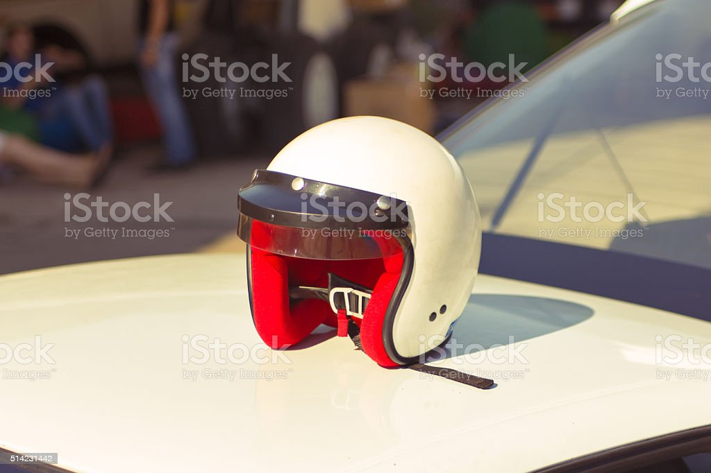 white racing helmet stock photo
