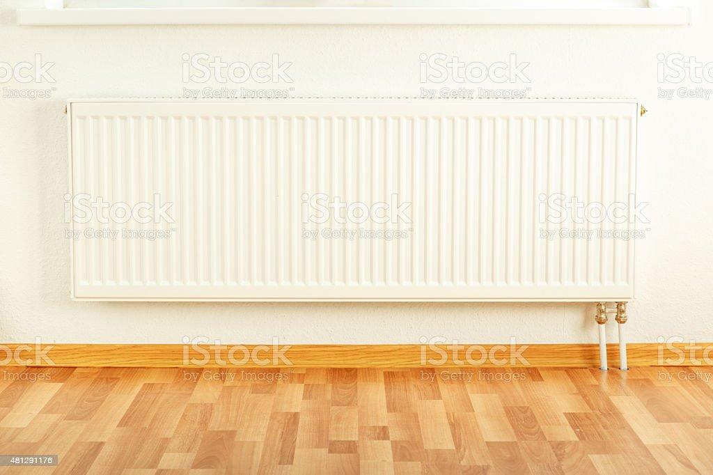 White radiator in apartment stock photo