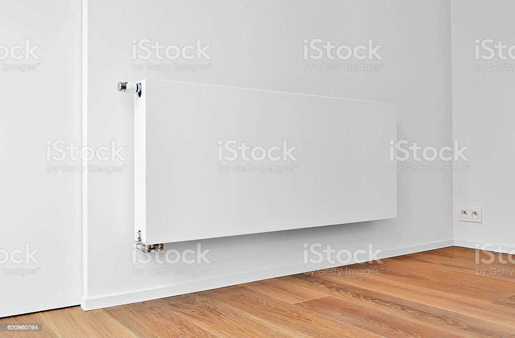 White radiator on wall in an appartment. stock photo