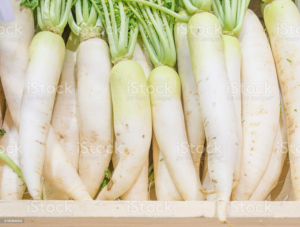 white radish harvested products on wooden planks stock photo