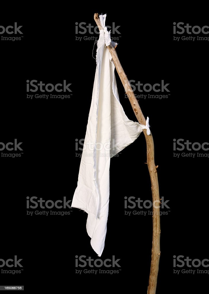 White rag tied to a stick on black background. stock photo