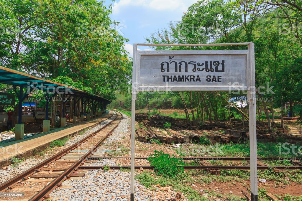 White Railway Station Signs Beside the Railway in Clear Day stock photo