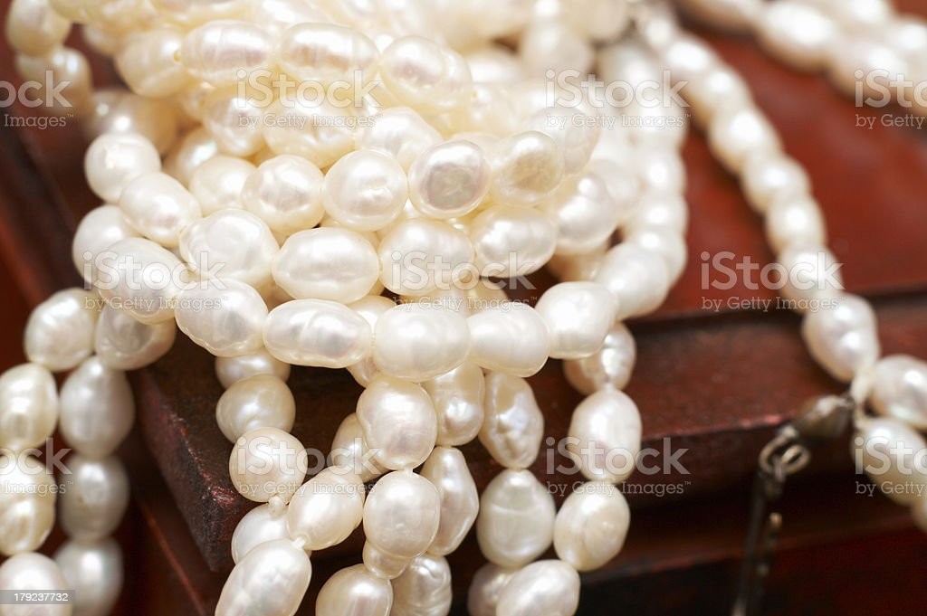 White real river pearls on wooden box royalty-free stock photo