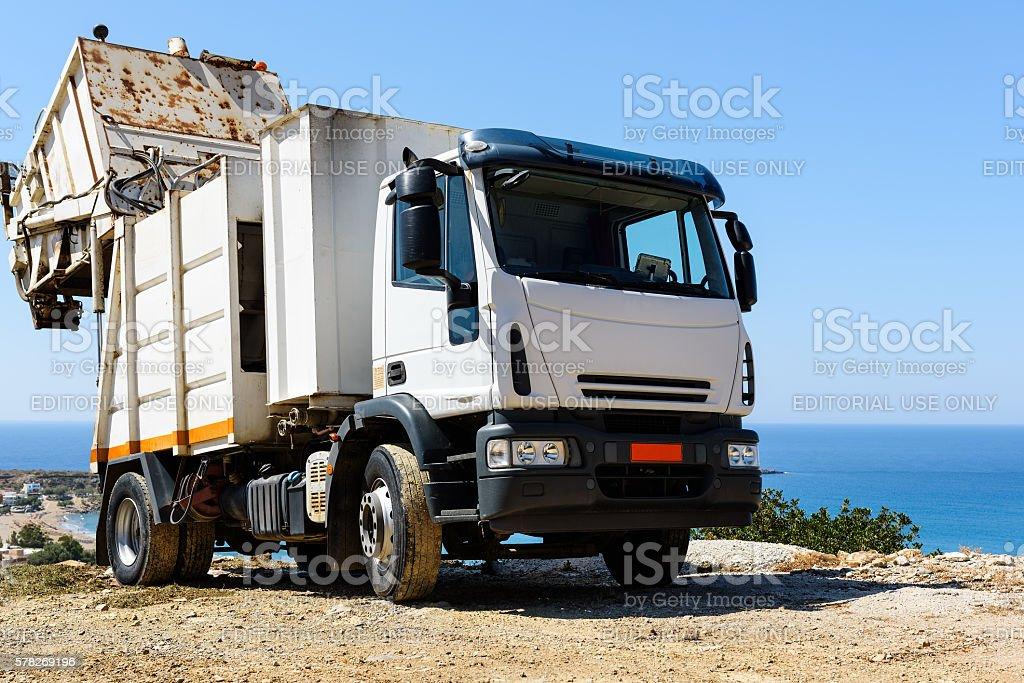 White recycling truck stays near Paleochora town on Crete island stock photo
