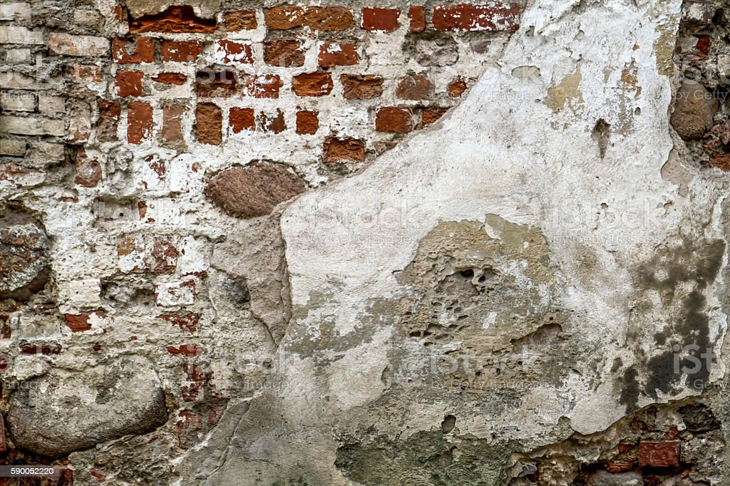 White red old brick painted wall with damaged plaster texture stock photo