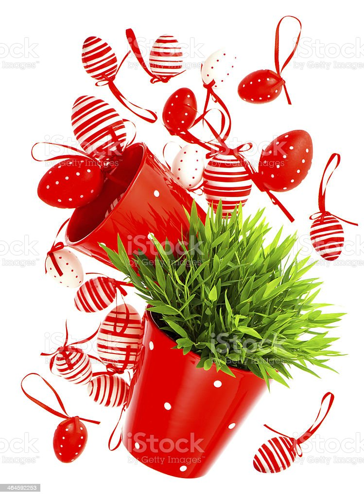 white red painted easter eggs with green grass stock photo