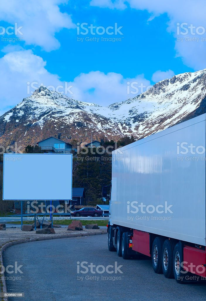 White refrigerated truck and big empty billboard stock photo