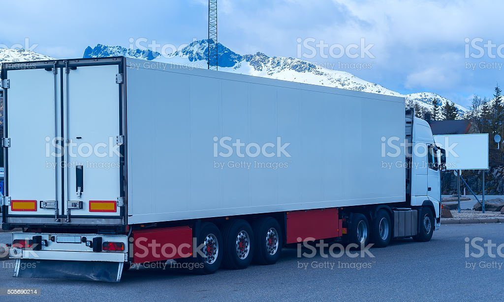 White refrigerated truck on background of the mountains stock photo