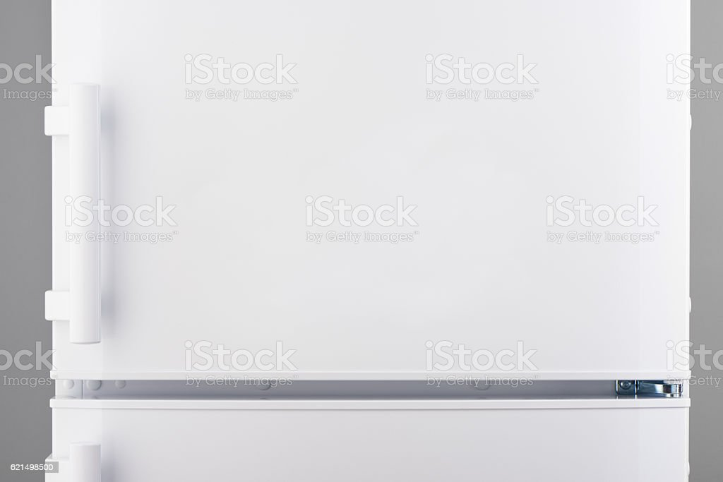 White refrigerator on gray stock photo