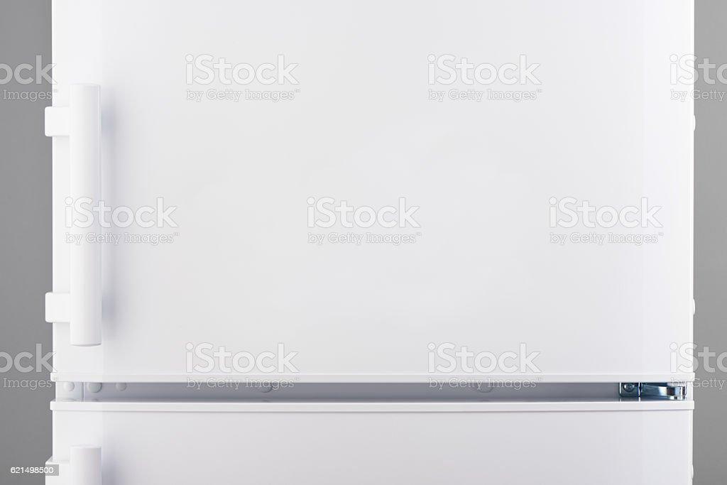 White refrigerator on gray stock photo
