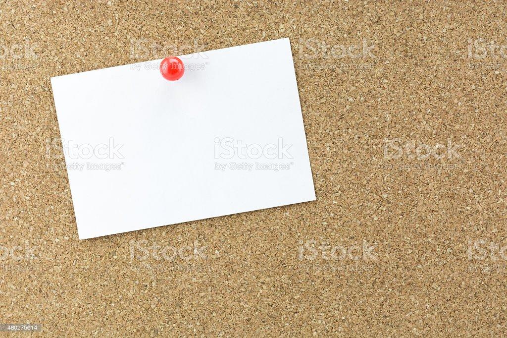 White reminder sticky note on cork board stock photo
