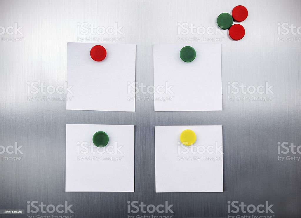 White reminders with magnets on fridge stock photo