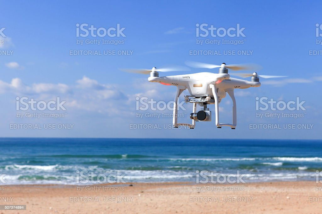 White remote controlled drone equipped with high resolution video camera stock photo