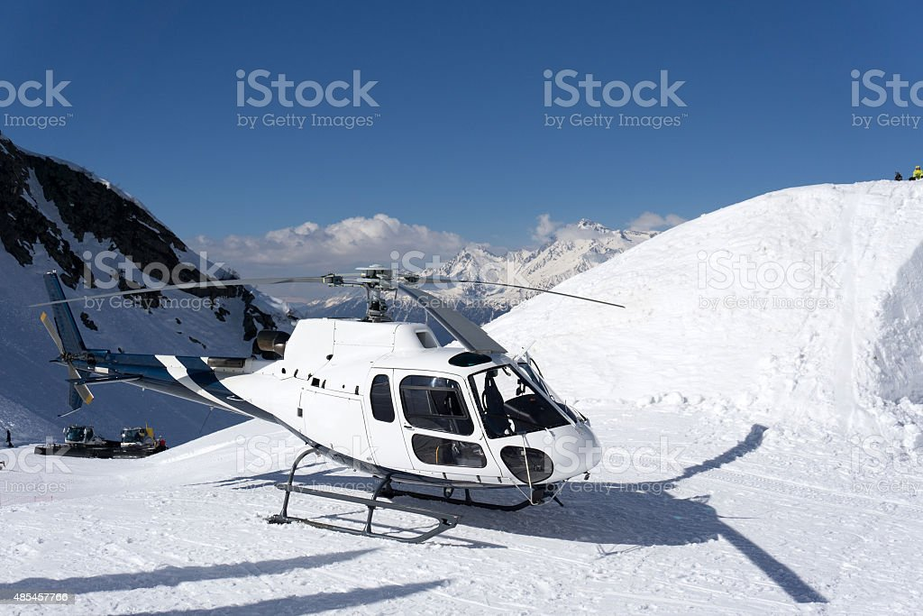 White rescue helicopter parked in the mountains stock photo