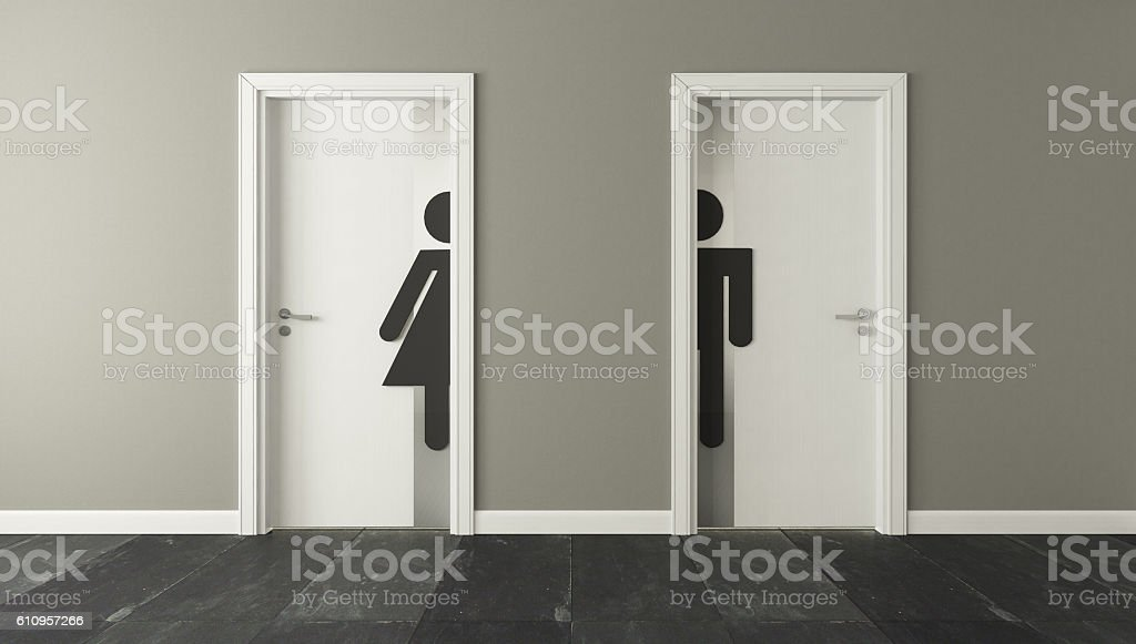 white restroom doors for male and female stock photo