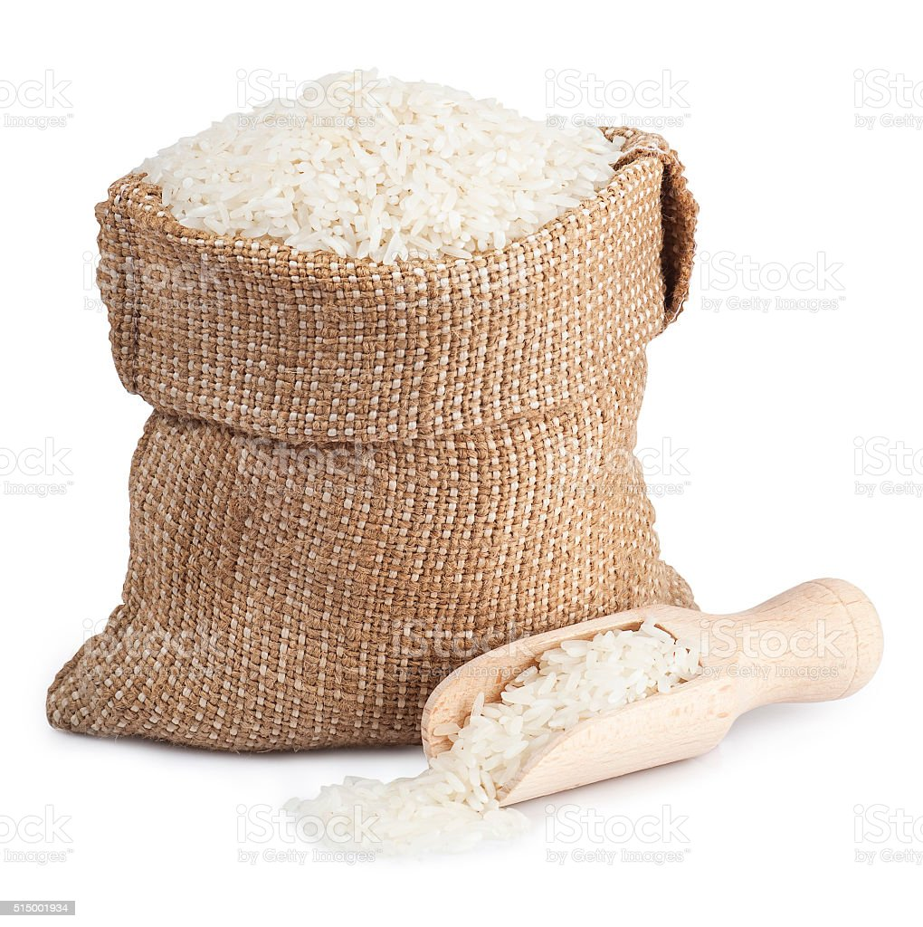 White rice in sack and wooden scoop  isolated on white stock photo